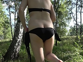 MILF in early pregnancy masturbates in the woods walks with dildo in pussy