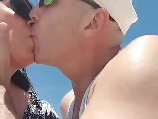 Slut wife kisses boss cock at the beach
