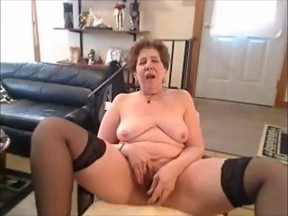 Hot breasted granny masturbating on cam