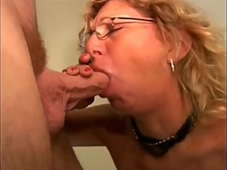 Mature mom with glasses sucking dick and drink cum