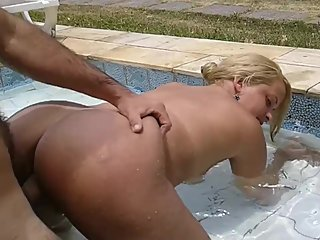Hot Blond Milf get Fucked from behind in the Pool