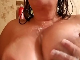 Mommy plays with big soapy tits in the shower