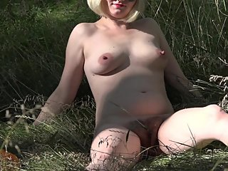 naked milf walks in the forest
