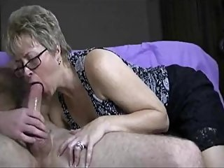 Grandma sucking boytoy dick while hubby recording