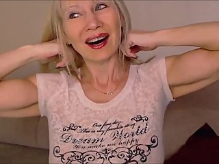 Beautiful Russian MILF flexes her pecs on cam