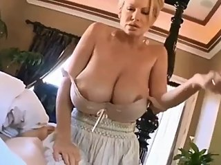 Busty mature stepmom woke up her stepson with her very big natural boobs