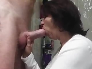 Mature stepmom sucks her stepson's big cock and swallows cum