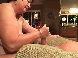 Fat granny give an energic handjob to her hubby till cum