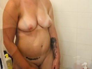 HOT BIG TIT WIFE SHOWER GETS ANGRY AFTER HUSBAND TRIES TO RECORD HER NAKED