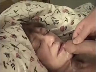 Granny lying on the couch get sperm in mouth