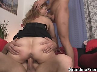 Hot busty mommy loves swallowing two cocks at once